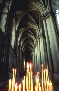 Candles Burn Inside European Cathedral